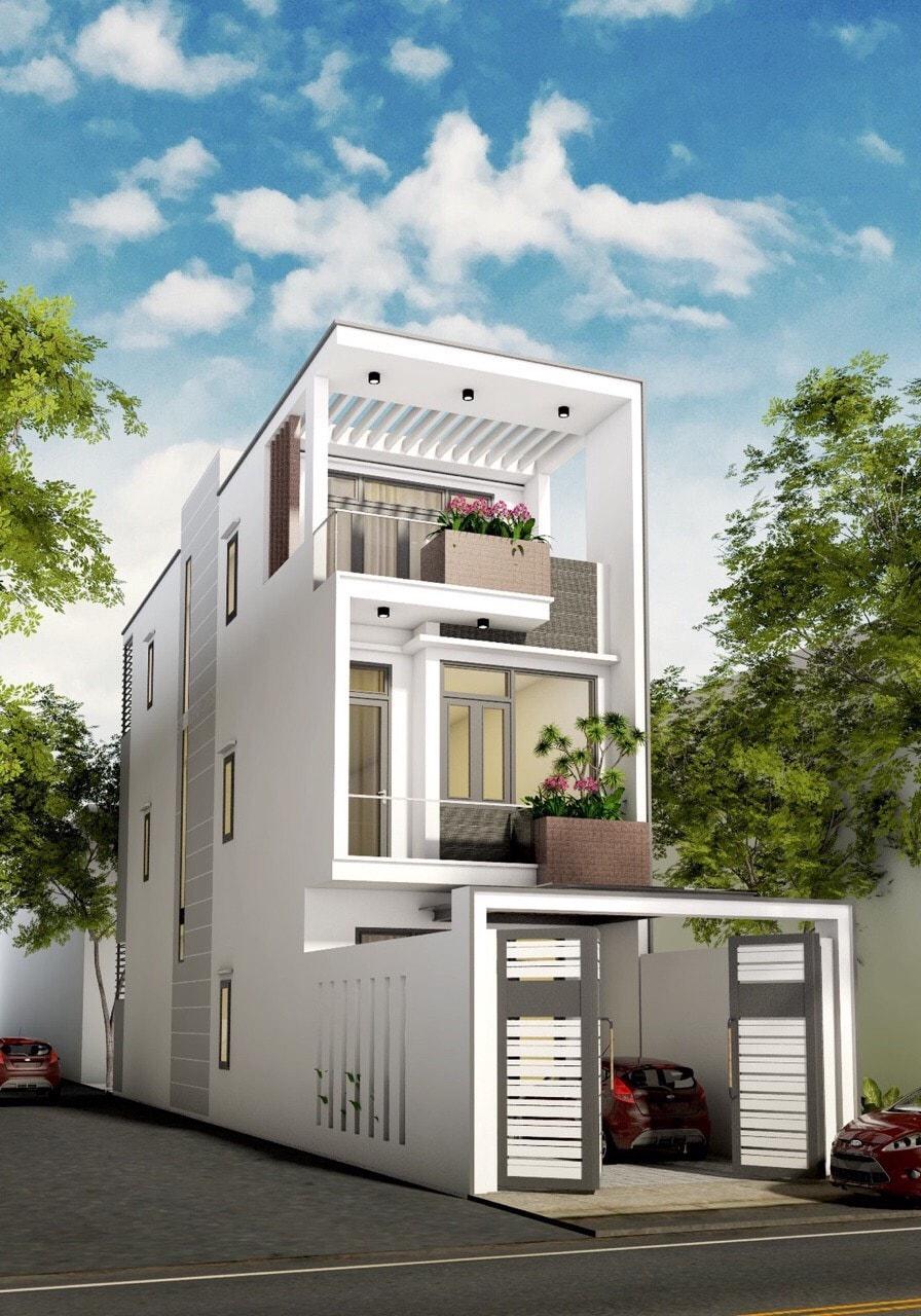 Nhà mặt tiền 5m hiện đại có gara và màu trắng là màu sắc chủ đạo