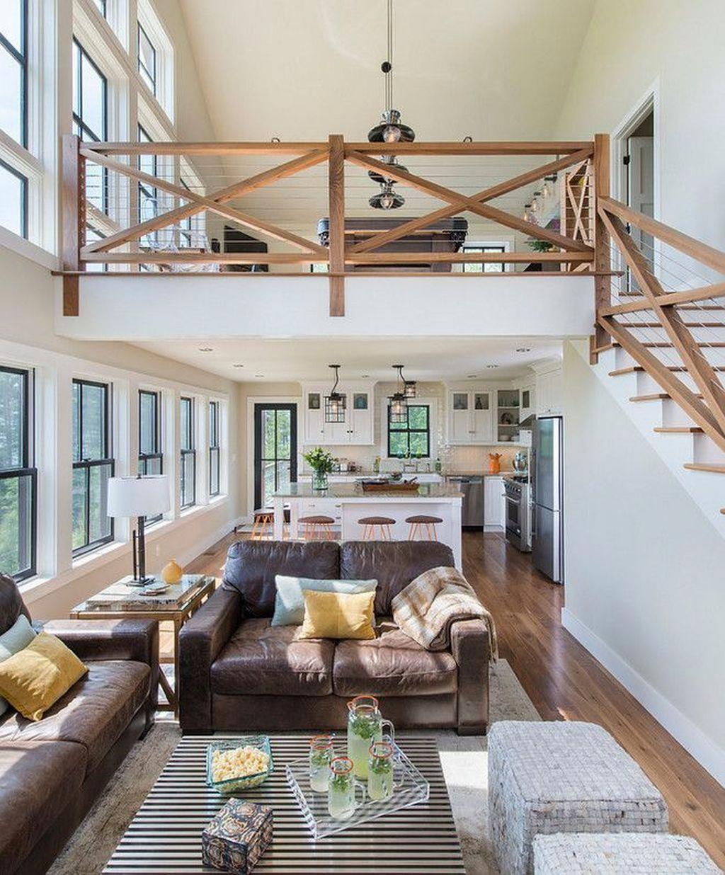 Mẫu 7: Mẫu thiết kế phòng khách nhà ống với cầu thang bục